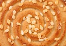 Sesame cake on a white background. Macro. Royalty Free Stock Photo