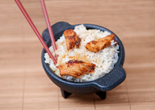 Sesame chicken in a black bowl Royalty Free Stock Images