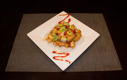 Sesame Chicken Dinner. Asian inspired Sesame Chicken Dinner over Rice Royalty Free Stock Photography