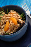 Sesame Chicken Salad. In a blue bowl Stock Photo