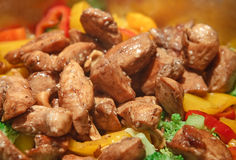 Sesame chicken stir-fry. Golden fried pieces of chicken breast served with crispy, colorful vegetables Stock Photos