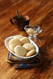Sesame Cookies. In white vase on wooden background Stock Images