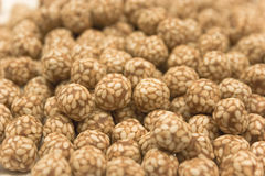 Sesame covered Chickpeas focus Royalty Free Stock Photo