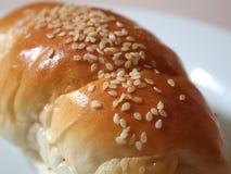 Sesame on dinner roll. A shot of sesame seeds on a lovely fresh dinner roll Stock Images