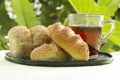 Sesame and garlic bread served with Hot Tea Stock Photo