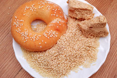 Sesame grains, halvah and donut Royalty Free Stock Images