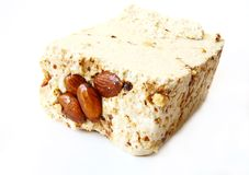 Sesame halva with almonds on white background Stock Photos