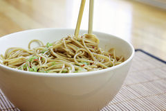 Sesame Noodles. In bowl with chopsticks stock photography
