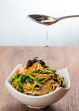Sesame oil drizzled on Asian sauteed vegetable salad. Royalty Free Stock Photo