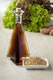 Sesame oil and roasted sesame seeds Royalty Free Stock Image