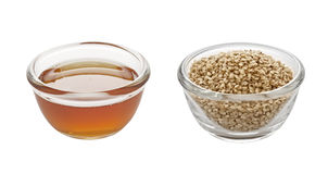 Sesame oil and seeds Stock Photography