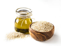 Sesame oil and seeds. Sesame oil in glass and seeds Stock Photos