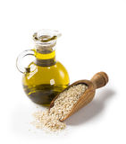 Sesame oil and seeds. Sesame oil in glass and seeds royalty free stock images