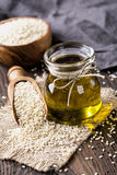 Sesame oil and seeds stock image