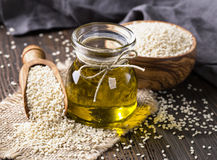 Sesame oil and seeds. Sesame oil in glass and seeds stock images