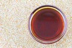 Sesame oil on white sesame seeds Stock Photos