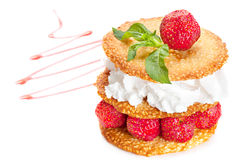 Sesame pastry with  strawberries. Sesame pastry with whipped cream and strawberries Royalty Free Stock Photos