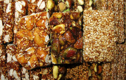 Sesame, Pistachios, and Nuts Sweets. Close-up of various traditional Arabic and Turkish sweets Stock Photo