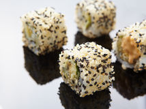 Sesame rolls on mirror Stock Image