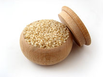 Sesame Seed. In wooden pot over white Royalty Free Stock Image