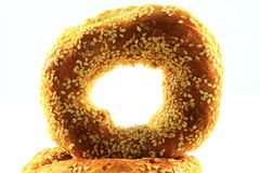 Sesame Seed Bagel. On top of another  isolated on a white background Royalty Free Stock Photos