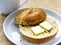 Sesame Seed Bagel with Butter Stock Images