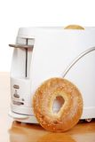 Sesame seed bagel leaning on toaster Royalty Free Stock Photos