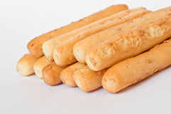 Sesame seed breadsticks on white Stock Image