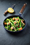 Sesame Seed Chicken with Green Asparagus and Sugar Snap Peas Royalty Free Stock Image