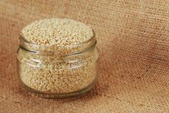 Sesame seed in jar Royalty Free Stock Image