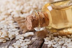 Sesame seed oil in a glass bottle with a cork. On the table macro horizontal Stock Photography