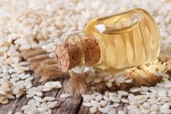 Sesame seed oil in glass bottle on the table horizontal Royalty Free Stock Image