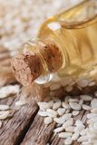 Sesame seed oil in glass bottle on the table macro Royalty Free Stock Photo