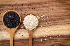Sesame seed in wooden spoon. Black and white sesame set up on wo. Grains and Cereals, Black and white seasame Royalty Free Stock Photos