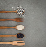 Sesame seed in wooden spoon. Black and white sesame set up on wo. Grains and Cereals, Black and white seasame Royalty Free Stock Images