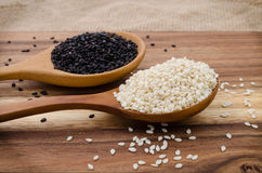 Sesame seed in wooden spoon. Black and white sesame set up on wo. Grains and Cereals, Black and white seasame Stock Photography