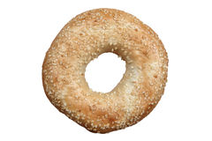 Sesame seeded bagel on a white background. Sesame seeded bagel bread roll cut out and isolated on a white background Royalty Free Stock Photography
