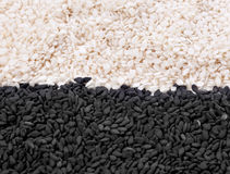 Sesame seeds. Black and white sesame seeds isolated on white royalty free stock photo