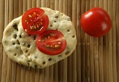 Sesame seeds biscuits. Over bamboo stripes stock photos