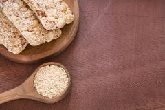 Sesame seeds and cereal bars Sesamum indicum. Sesame seeds contain a high amount of protein Royalty Free Stock Image