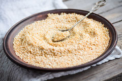 Sesame seeds in a clay dish, a teaspoon of seeds Royalty Free Stock Photo
