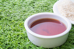 Sesame seeds on grass background Stock Photo
