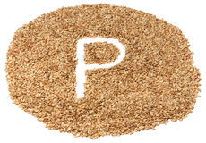 Sesame seeds with letters Royalty Free Stock Photography