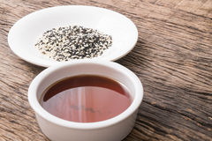Sesame seeds oil and sesame seeds Royalty Free Stock Images
