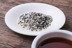 Sesame seeds oil and sesame seeds Stock Photos