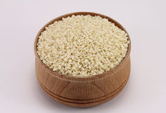 Sesame seeds in a round wooden form Stock Photo
