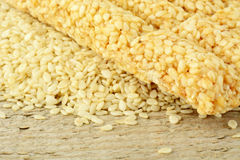 Sesame seeds scattered on wooden mat in the corner Royalty Free Stock Photo