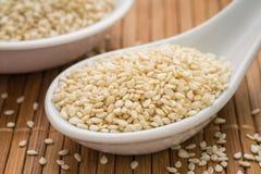 Sesame seeds on spoon. Sesame seeds on ceramic spoon stock photos