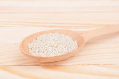 Sesame seeds in a spoon Royalty Free Stock Photos
