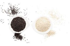 Sesame seeds on white. Royalty Free Stock Image